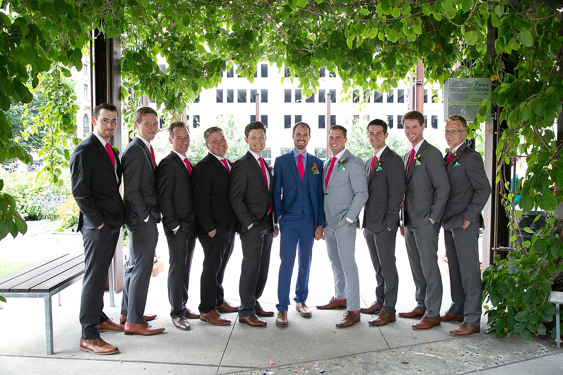 groomsmen in navy and coral photographed by Katrina Cross Photography