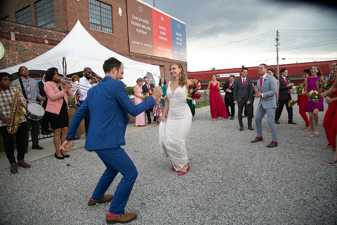 bride and groom dance at the Eastern after wedding ceremony with Katrina Cross Photography
